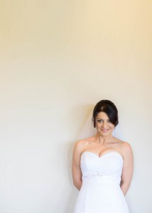 beautiful-bride-by-white-wall