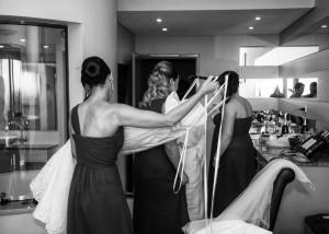 bridesmaids-helping-bride-get-ready